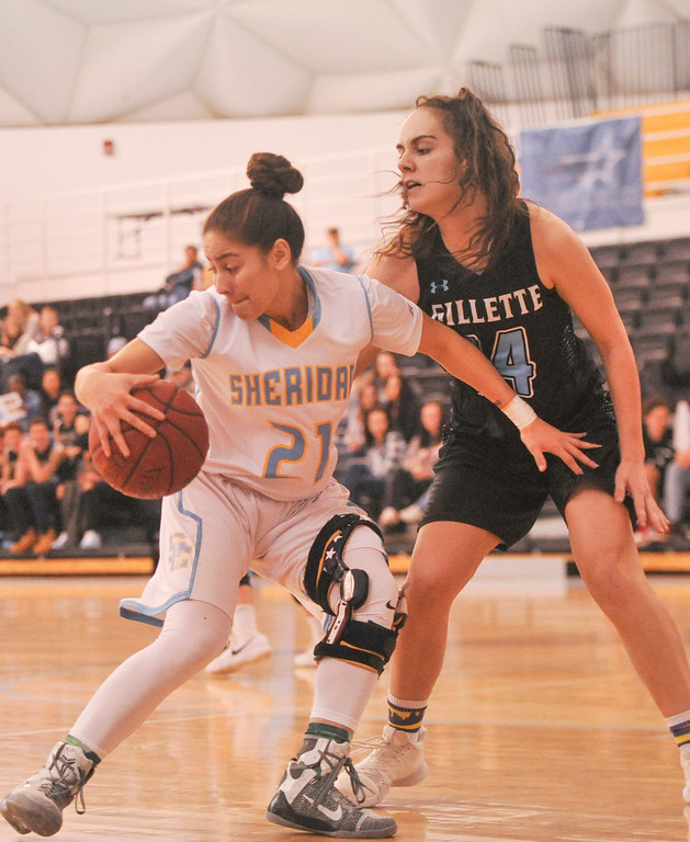 Justin Sheely | The Sheridan Press<br /> Sheridan's Aloma Solovi drives against Gillette College's Lily Sara at the Bruce Hoffman Golden Dome Friday March 2, 2018. The Lady Generals won 68-40 to advance to the Region IX quarterfinals.