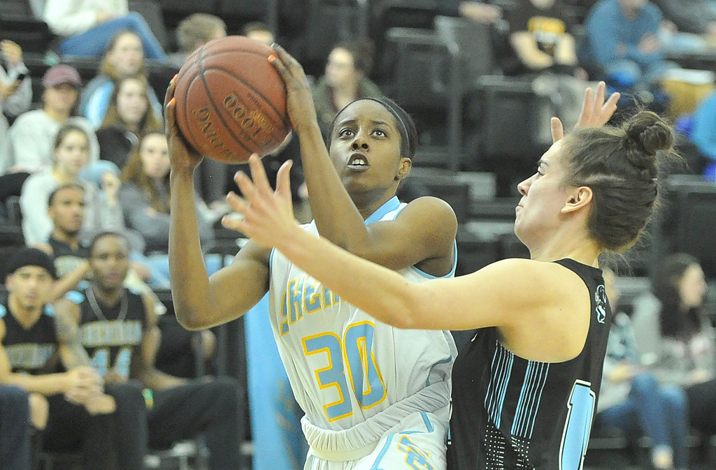 Justin Sheely | The Sheridan Press<br /> Sheridan's Carmen Ramey goes for a layup against Gillette College's Lyly Sara at the Bruce Hoffman Golden Dome Friday March 2, 2018. The Lady Generals won 68-40 to advance to the Region IX quarterfinals.