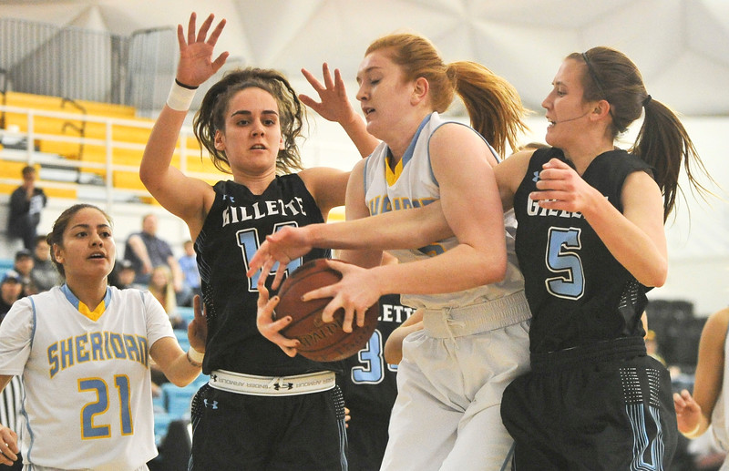 Justin Sheely | The Sheridan Press<br /> Sheridan's Kassie Hoyer, center, rebounds against Gillette College's Lily Sara, left, and  Lila Filip at the Bruce Hoffman Golden Dome Friday March 2, 2018. The Lady Generals won 68-40 to advance to the Region IX quarterfinals.