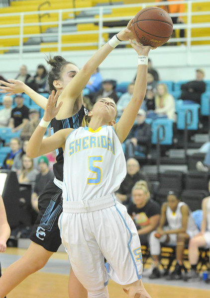 Justin Sheely | The Sheridan Press<br /> A shot by Sheridan's Lyly Jex is blocked by Gillette College's Lyly Sara at the Bruce Hoffman Golden Dome Friday March 2, 2018. The Lady Generals won 68-40 to advance to the Region IX quarterfinals.
