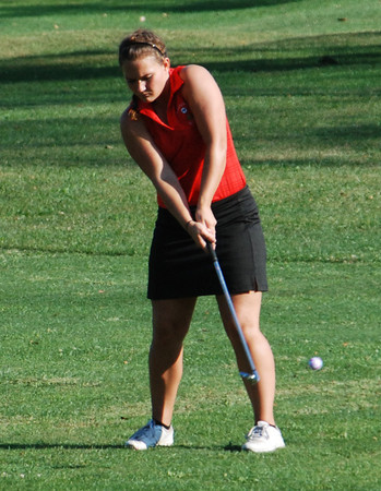 Rushville's Kylie Martindale chips to the No. 12 green during action at Antler Pointe Wednesdsay.