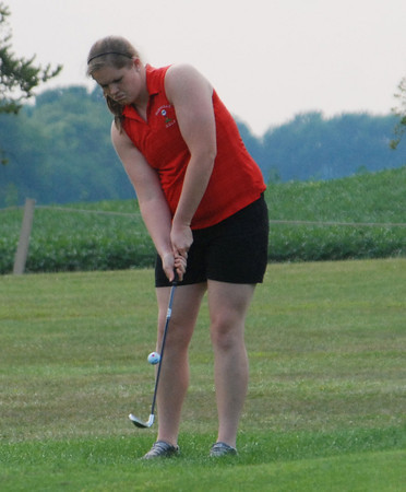 Rushville's Kelsi Ash chips to the green on No. 7 at Antler Pointe golf course during action against Shelbyville and Mt. Vernon.