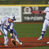 Eric Bonzar—The Morning Journal<br /> Crushers shortstop Parker Norris fields a grounder up the middle.