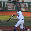 Eric Bonzar—The Morning Journal<br /> Crushers ' Jordan Dean connects on a pitch.