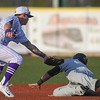 Eric Bonzar—The Morning Journal<br /> Crushers second baseman Jordan Dean applies the tag, but come up without the baseball, as Joliet's Melvin Rodriguez steals second.