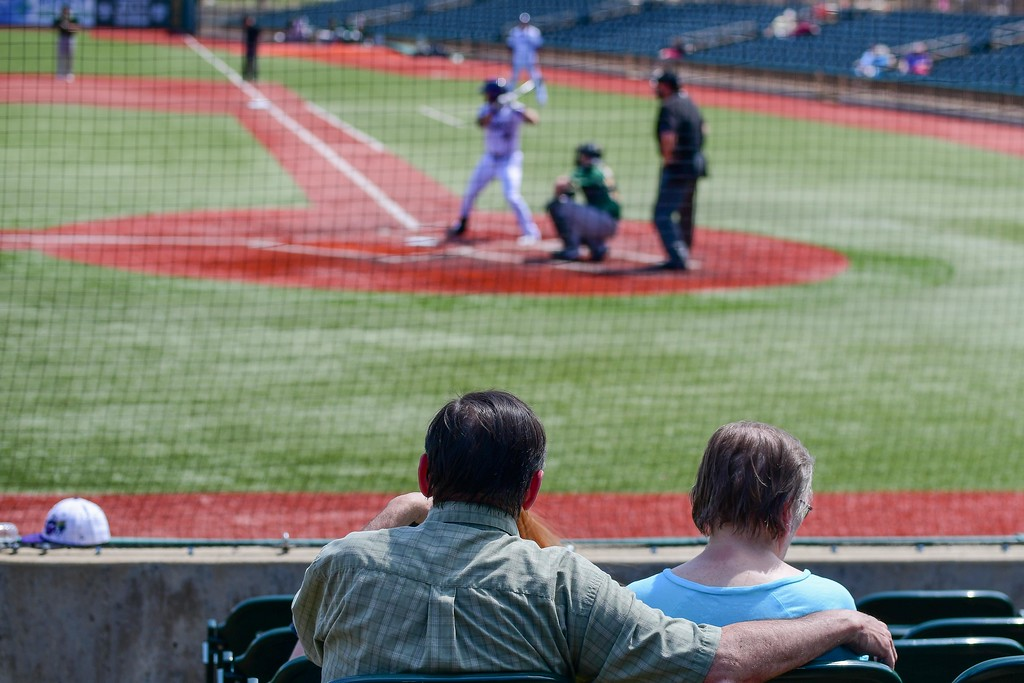 . Eric Bonzar�The Morning Journal<br> A couple takes in the Lake Erie Crushers home opener, for Senior Day, at Sprenger Stadium, May 15, 2018. The Crushers extended their win streak to two games, with a 2-1 home opener win over the Normal CornBelters.
