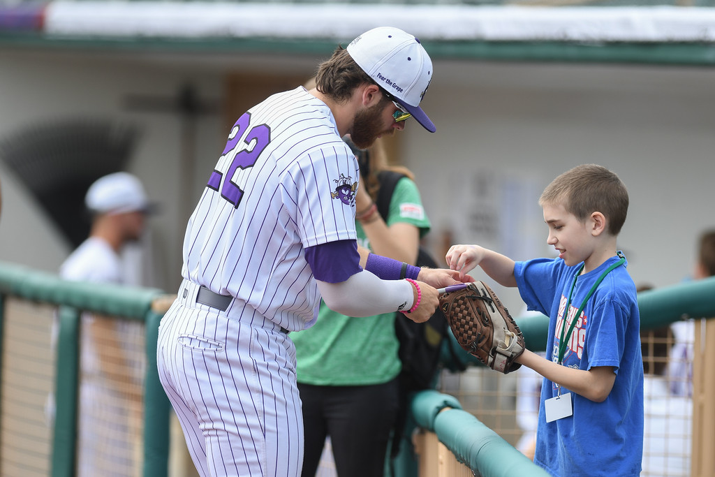 . Eric Bonzar�The Morning Journal<br> Outfielder Douglas Trimble signs an autograph for 9-year-old Ethan Wilmeth, during the Crushers\' home opener, May 15, 2018. The fourth-grader attended the game with his fellow classmates from Copopa Elementary School, in Columbia Station.