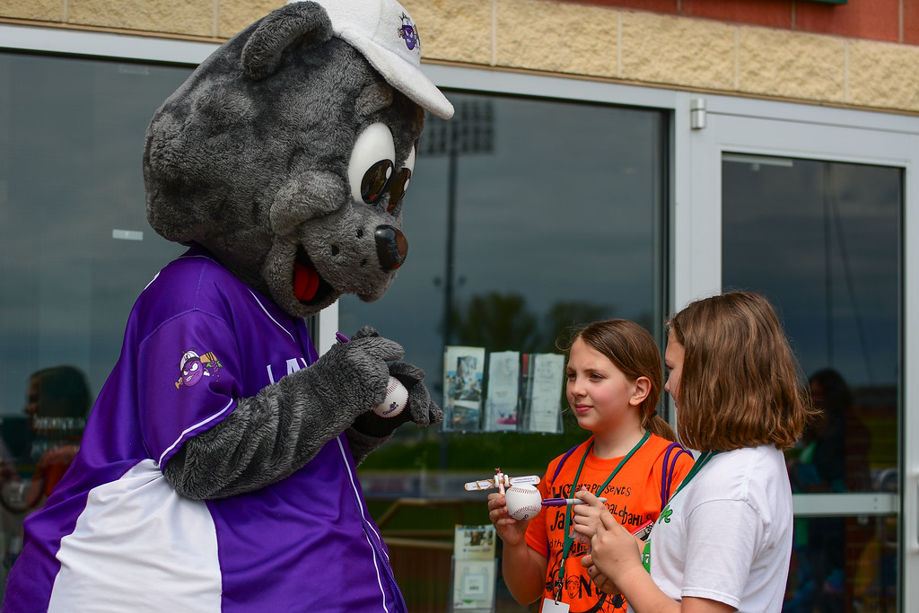 . Eric Bonzar�The Morning Journal<br> Stomper signs autographs for 10-year-olds Nina Balachino, left, and Bailey Gonia, during the Crushers\' home opener, May 15, 2018. The two attended the game with their fellow classmates from Copopa Elementary School, in Columbia Station.