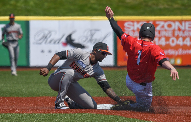 Eric Bonzar—The Morning Journal<br /> Crushers' Brendan Costantino is tagged out at second by Schaumburg shortstop Mikal Hill, in the bottom of the fourth inning, May 18, 2016.