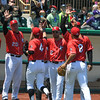 Eric Bonzar—The Morning Journal<br /> The Lake Erie Crushers celebrate a 3-0 win over the Schaumburg Boomers, May 18, 2016.