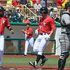 Eric Bonzar—The Morning Journal<br /> Crushers' Daniel Aldrich (31) is greeted at home plate, by third baseman Juan Avila, after jacking a three-run homerun in the bottom of the fifth inning, May 18, 2016.