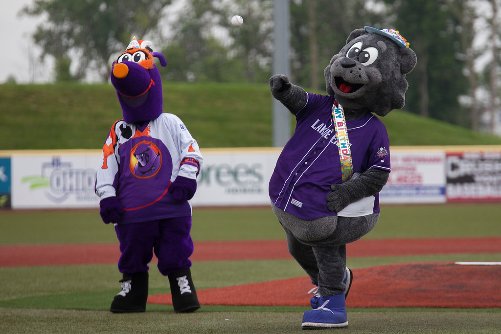. Jen Forbus - The Morning Journal  In honor of his 10th birthday Crusher mascot, Stomper, throws out the ceremonial first pitch of the game. He\'s accompanied by Boomer of the Youngstown Phantoms hockey team.