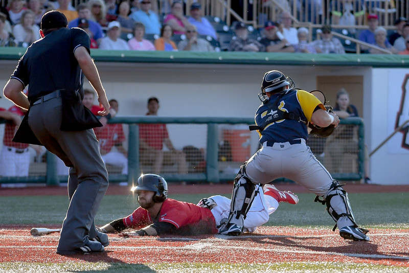 Eric Bonzar—The Morning Journal<br /> The Crushers' Parker Norris slides into home safe, under the tag of Beach Bums catcher Gaby Juarbe, June 17, 2016.