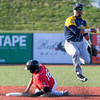 Eric Bonzar—The Morning Journal<br /> The Crushers' Jose Barraza slides into a force out at second base as Traverse City second baseman Steven Patterson throws to first for the double play, June 17, 2016.