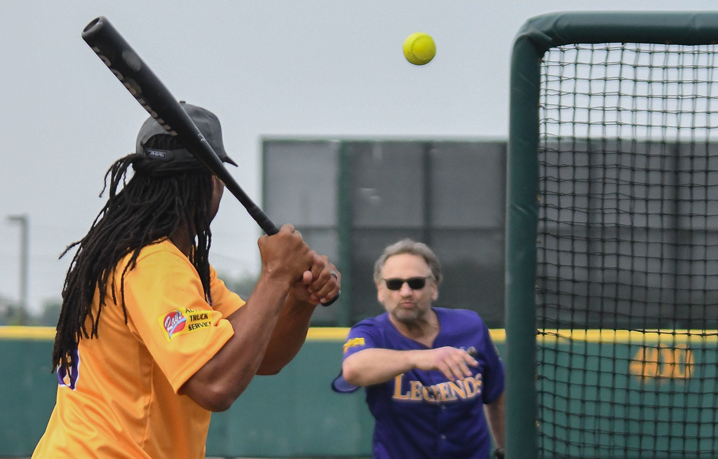 . Eric Bonzar�The Morning Journal Former Cleveland Browns defensive tackle Bob Golic tosses batting practice pitches to former Cleveland Browns wide receiver Josh Cribbs, prior to the start of the Cleveland Sports Legend Game, at Sprenger Stadium, June 17, 2017.