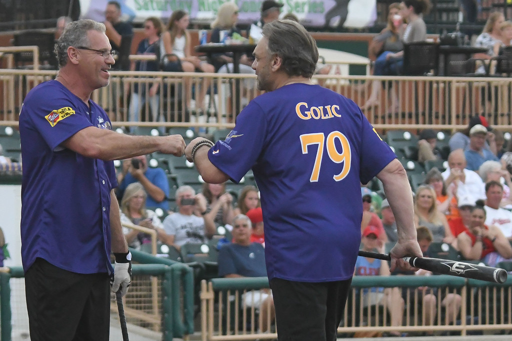 . Eric Bonzar�The Morning Journal Former Cleveland Browns defensive tackle Bob Golic gets a fist bump from former Cleveland Indians left fielder Joe Charboneau during the Cleveland Sports Legend Game, at Sprenger Stadium, June 17, 2017.