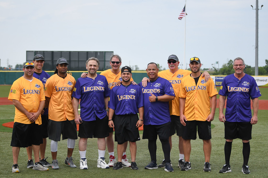 . Eric Bonzar�Thee Morning Journal Legends from the grid iron and the field of dreams came together for a night of laughs, memories and a little bit of softball for the inaugural Cleveland Sports Legend Game held at the Lake Erie Crushers\' Sprenger Stadium, June 17, 2017. Pictured from left to right are: Andrew Davis, Matt Wilhelm, Josh Cribbs, Bob Golic, Bernie Kosar, Carlos Baerga Jr., Carlos Baerga, Len Barker, Travis Hafner and Joe Charboneau.