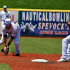 Jon Behm - The Morning Journal<br> Crushers short stop Trevor Achenbach flips the ball to second baseman Jordan Dean to start a double play during the top of the second inning against Evansville on July 4, 2017.