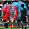 Jon Behm - The Morning Journal<br> A pair of fans participate in an on field game during a break between inning on July 4, 2017.