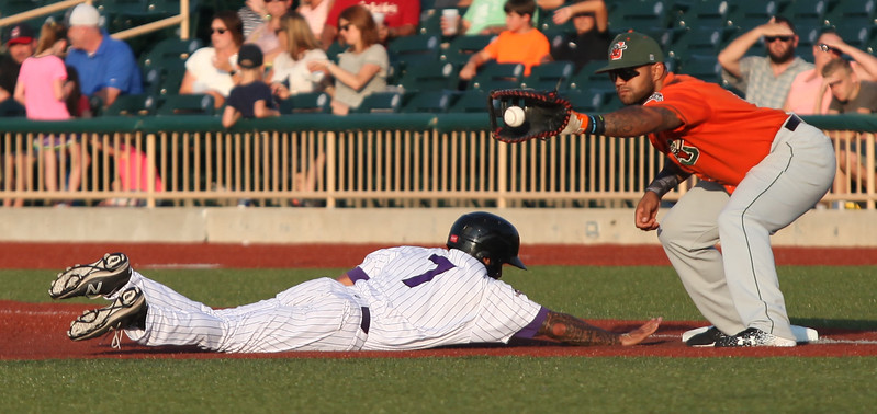 Randy Meyers - The Morning Journal<br> The Crushers' L.J. Kalawaia dives back to first safely as the throw comes in to Rock Shoulders of Joliet on July 14.