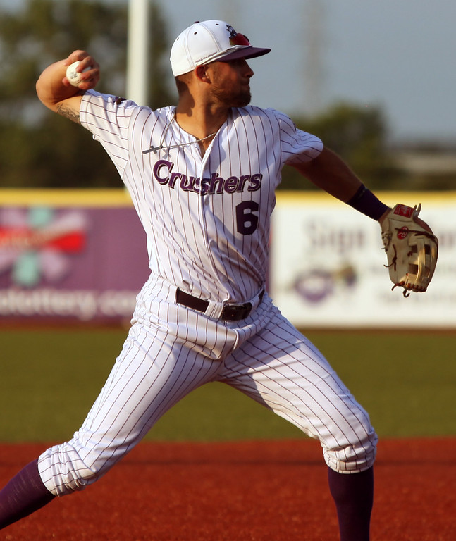. Randy Meyers - The Morning Journal<br> Crushers third baseman Josh McAdams fields a ground ball and throws to first for the out against Joliet on July 14.