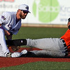 Randy Meyers - The Morning Journal<br> The Crushers infielder Parker Norris tags out Edwin Gomez of Joliet at second as he tried to stretch out a base hit July 14.