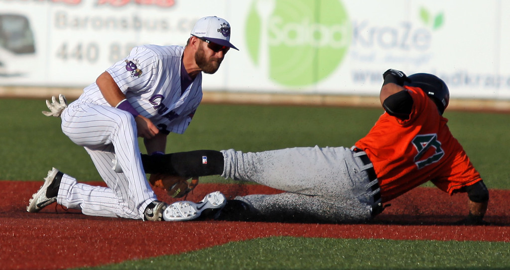 . Randy Meyers - The Morning Journal<br> The Crushers infielder Parker Norris tags out Edwin Gomez of Joliet at second as he tried to stretch out a base hit July 14.
