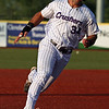 Randy Meyers - The Morning Journal<br> Connor Simonetti prepares to round third and score the Crushers first run against Joliet on July 14.