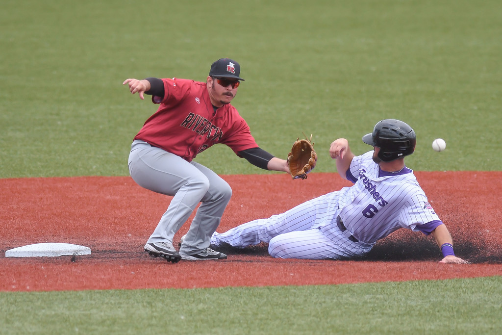 . Eric Bonzar�The Morning Journal Crushers\' Josh McAdams steals second base, beating the tag of River City shortstop Johnny Morales, July 25, 2017.
