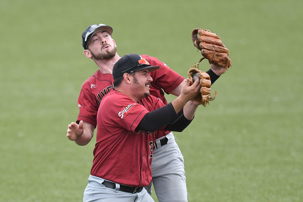 . Eric Bonzar�The Morning Journal River City left fielder Jimmy Kerrigan collides with shortstop Johnny Morales, as Morales calls off an infield pop-fly, in the bottom of the second inning, July 25, 2017.