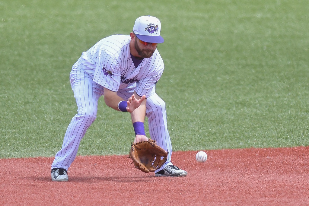 . Eric Bonzar�The Morning Journal Crushers\' shortstop Parker Norris fields a grounder in the top of the fifth inning, July 25, 2017.