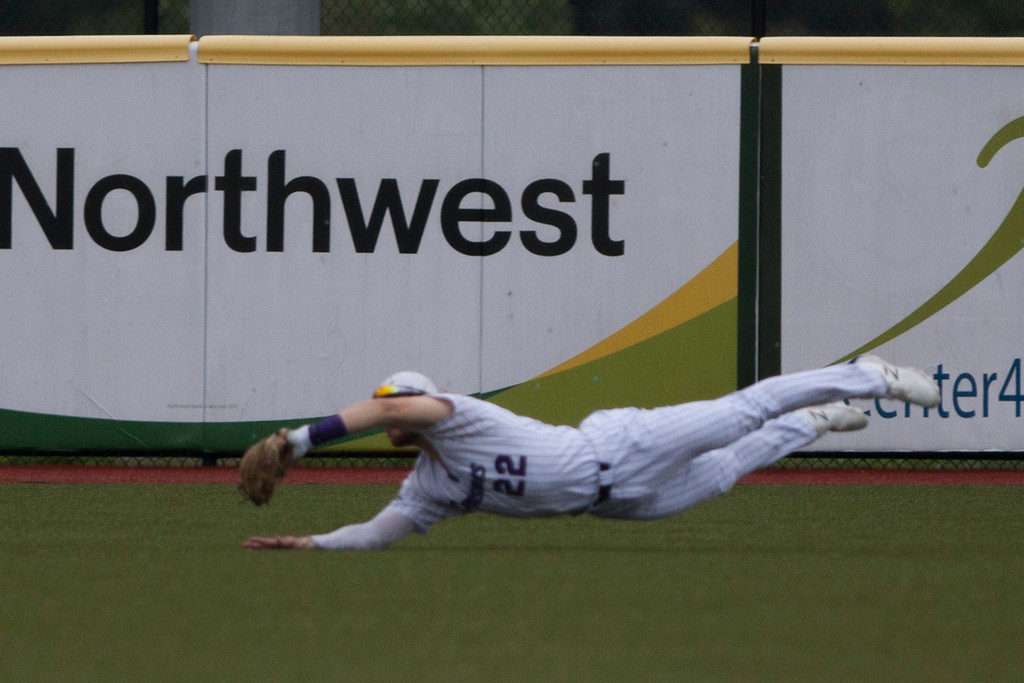 . Jen Forbus - The Morning Journal<br> Lake Erie right fielder Doug Trimble makes a diving catch in the outfield on Aug. 1.