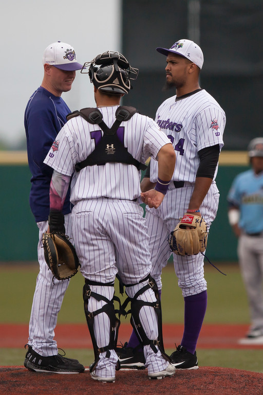 . Jen Forbus - The Morning Journal<br> Manager Cam Roth meets with his battery, pitcher Alex Romera and catcher Bryan De La Rosa, on the mound on Aug. 1.