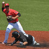 Eric Bonzar—The Morning Journal<br /> Miners designated hitter Edison Sanchez slides into a force out at second as Crushers shortstop Eric Grabe looks to throw to first, Aug. 3, 2016.