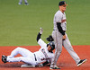 Jim Bobel/JBobel@morningjournal.com<br /> Crusher's Trevor Stevens is safe into second on a passed ball in the first inning as Boomers Ben Kline watches the play.