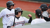 Jim Bobel/JBobel@morningjournal.com<br /> Crusher's Trevor Stevens and Anderson Hidalgo, left, are met by their teamates after they scored in the first inning against the Boomers.