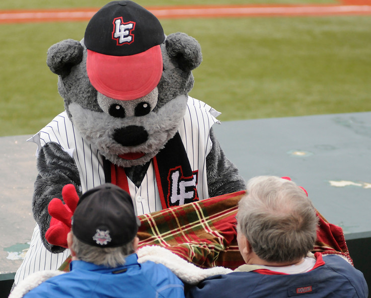 Jim Bobel/JBobel@morningjournal.com<br /> Stomper helps cover a couple with a heavy blanket before the start of the Lake Erie Crushers home opener. With light rain and a temperature of 49 degrees made for a chilly game.