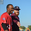 Eric Bonzar—The Morning Journal<br /> Crushers' Marquis Riley and Evansville Otters pitcher Hunter Ackerman share a laugh prior to game time, July 1, 2016.