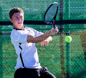 Vandergrift's Zac Delmonico returns the volley from Lake Travis in a boys double during 25-6A tennis finals between Lake Travis Cavaliers and the Vandergrift Vipers at Lake Travis High School on Wednesday October 12, 2016.