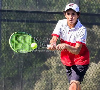 Lake Travis' Jess Wikso returning the serve in a boys double during 25-6A tennis finals between Lake Travis Cavaliers and the Vandergrift Vipers at Lake Travis High School on Wednesday October 12, 2016.
