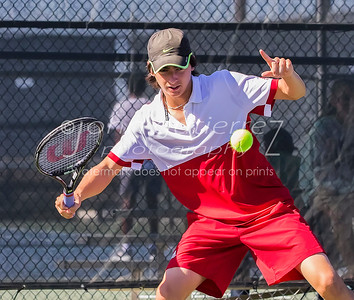 Lake Travis' Kyler Bender sets to return the ball in a boys double during 25-6A tennis finals between Lake Travis Cavaliers and the Vandergrift Vipers at Lake Travis High School on Wednesday October 12, 2016.