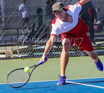 Lake Travis' Kyler Bender reaches low to return the ball in a boys double during 25-6A tennis finals between Lake Travis Cavaliers and the Vandergrift Vipers at Lake Travis High School on Wednesday October 12, 2016.