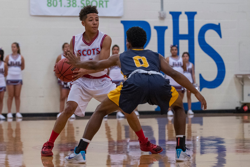 Tayson Doss (4) looks for open teammates to pass to as defender Elijah Mason (0) guards him at  Ben Lomond High School in Ogden on November 20, 2016.
