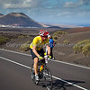 Cycle stage of the Lanzarote Ironman 2009.  The long winding road cycling up the mountains in the Lanzarote Ironman.  You have to be one tough athlete to even think about doing this!<br /> <br /> The downside to shooting with a short lens is that you can't get the 'look' people associate with this kind of photography but the upside is that you get closer and get the reactions.