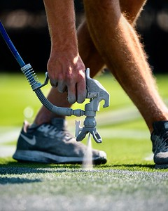 Las Vegas Raiders assistant field manager McCade Lynch paints the field in preparation for the Las Vegas Raiders' inaugural home opener at Allegiant Stadium, Saturday, September 19, 2020, in Las Vegas, Nev.