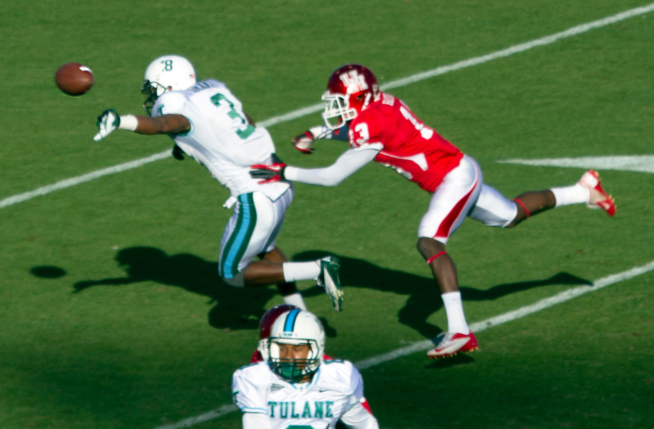 Bates prevents a Tulane pass receiver from making a touchdown