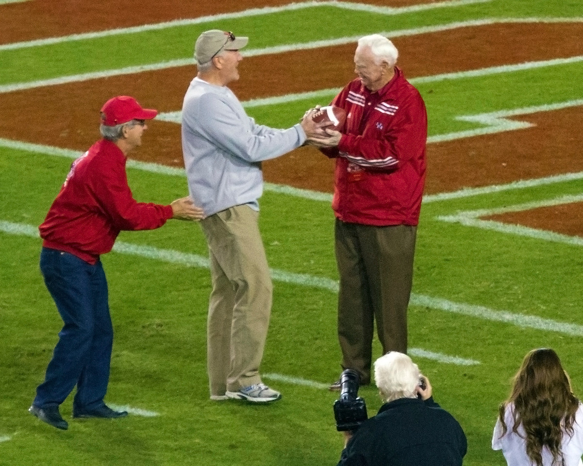 Yeoman receives the ball from generations of past players