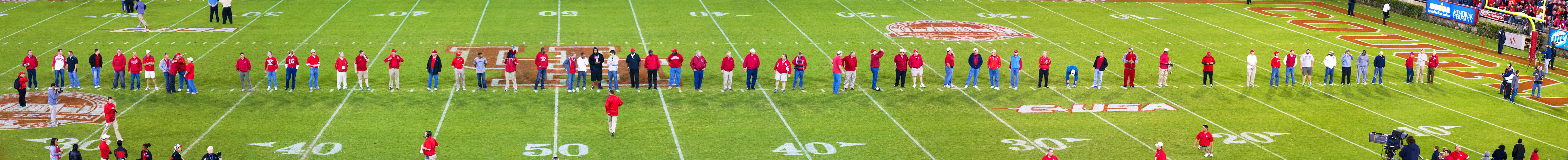 Past UH football players.  Bill Yeoman is on the far right -- football on far left