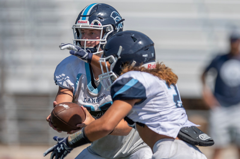 Layton High's football team prepares for the 2020 season in the August heat. At Layton high school, In Layton, on August 3, 2020.