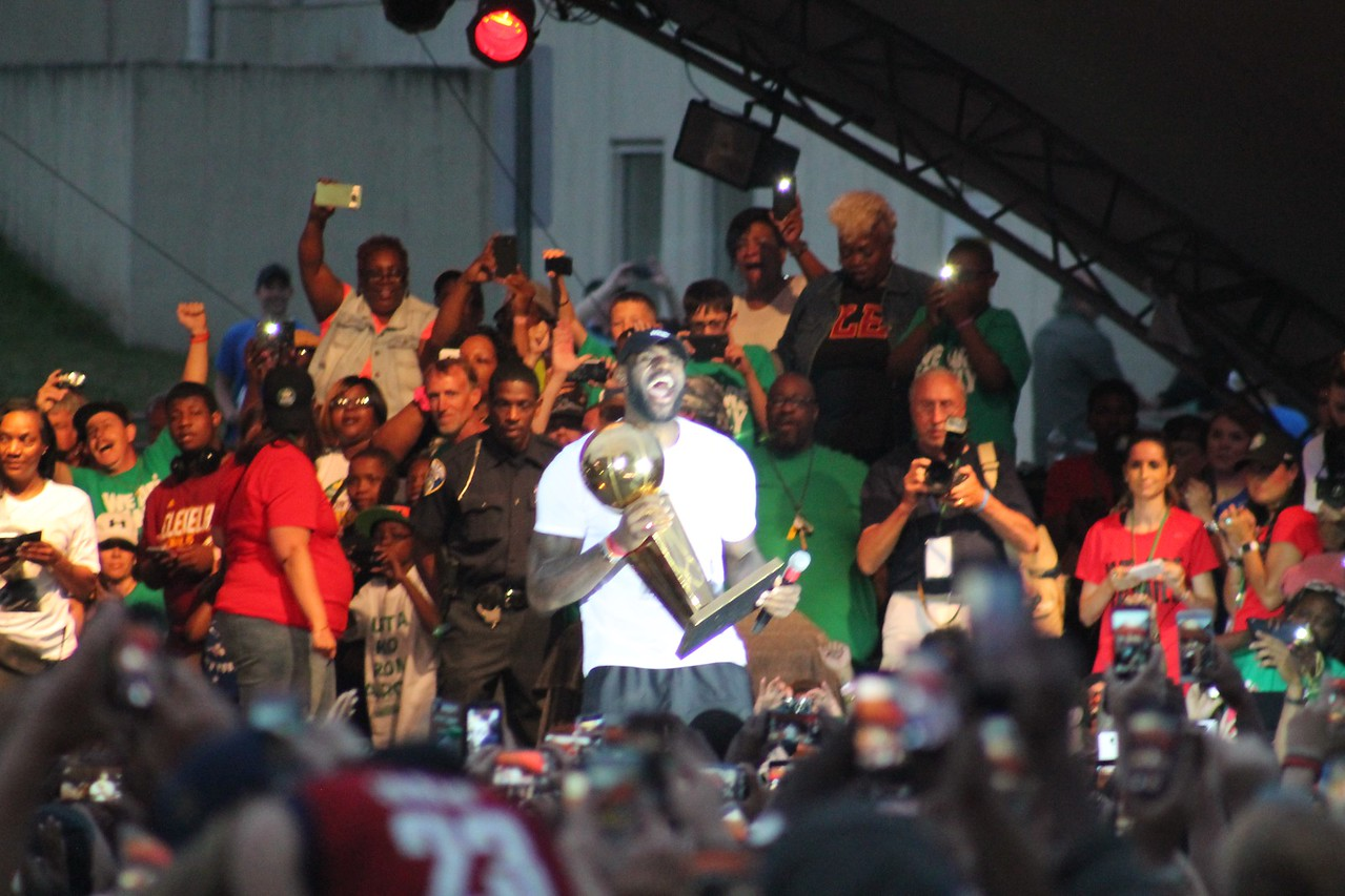 LAWRENCE PANTAGES/CHRONICLE LeBron James holds the Larry O'Brien trophy in Akron on Thursday, June 23.